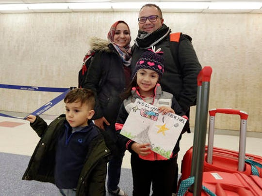 Munther Alaskry, accompanied by his wife Hiba, son Hassan, and daughter Dima arrive at New York's JFK International Airport, in New York, Friday, Feb. 3, 2017. Alaskry and his family arrived at New York's Kennedy Airport after the Trump administration reversed course and said he and other interpreters who supported the U.S. military could come to America. They spent nearly a week in limbo in Baghdad, thinking their hopes of starting a new life free from death threats had been shattered.