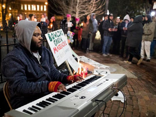 "Jerone Williams plays piano during a Bowling Green ""massacre"" remembrance gathering on Friday, Feb. 3, 2017, at Fountain Square Park in Bowling Green, Ky. The ""massacre"" that never happened has Bowling Green in the national news again — something that has not happened since a sinkhole swallowed several prized Corvettes at a museum."