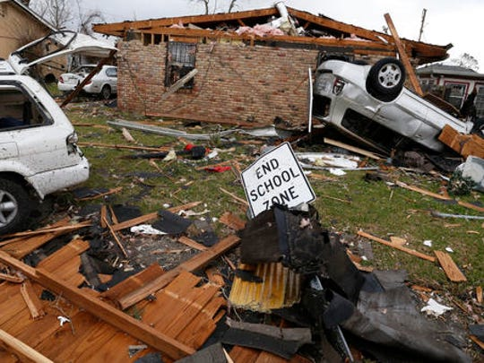 A scene of overturned cars and damaged homes remain a day after a tornado touched down in eastern New Orleans, Wednesday, Feb. 8, 2017.