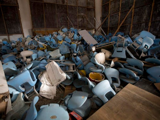 This Feb. 2, 2017 photo shows seats jumbled in a pile inside Maracana stadium in Rio de Janeiro, Brazil. The historic stadium, site of the opening and closing ceremony, has been vandalized as stadium operators, the Rio state government, and Olympic organizers, have fought over $1 million in unpaid electricity bills and management of the venue.