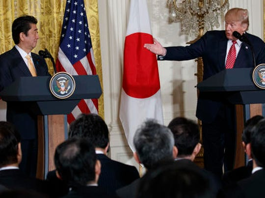 President Donald Trump speaks during a news conference with Japanese Prime Minister Shinzo Abe, Friday, Feb. 10, 2017, in the East Room of the White House in Washington.