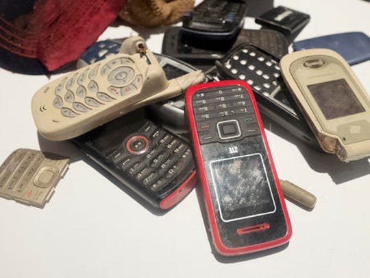 "A pile of mobile phones are some of the items left behind by migrants illegally crossing the U.S.-Mexican border on display in the ""State of Exception"" exhibit, Friday, Feb. 10, 2017 in New York. The exhibit at the Sheila C. Johnson Design Center at the Parsons School of Design continues through April 17."