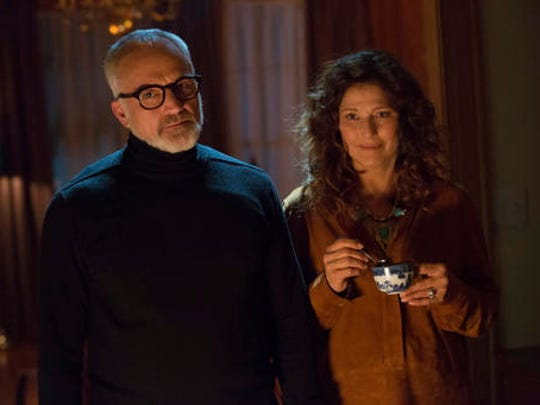 "This image released by Universal Pictures shows Catherine Keener, right, and  Bradley Whitford in a scene from, ""Get Out."""