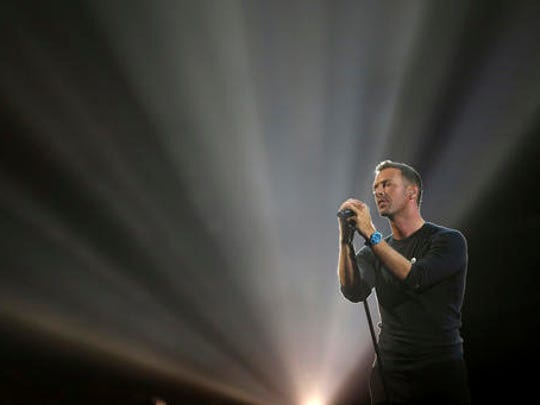 Singer Chris Martin performs a George Michael song on stage at the Brit Awards 2017 in London, Wednesday, Feb. 22, 2017.