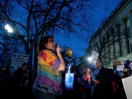 Activists and protesters with the National Center for Transgender Equality rally in front of the White House, Wednesday, Feb. 22, 2017, in Washington, after the Department of Education and the Justice Department announce plans to overturn the school guidance on protecting transgender students.