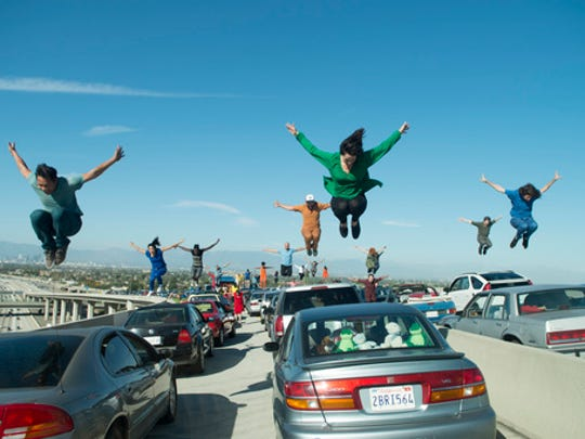 "This image released by Lionsgate shows a dance scene from the Oscar-nominated film, ""La La Land."" It's not easy to stage a successful dance scene for the cameras, especially on a highway interchange, but when such a scene works, it can be memorable."