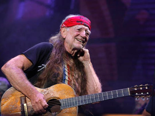 FILE - In this Sept. 9, 2007, file photo, Willie Nelson performs at Farm Aid on Randall's Island in New York.   Nelson, the children of the late reggae icon Bob Marley and comedian Whoopi Goldberg are just a few of the growing number of celebrities publicly jumping into the marijuana industry and eyeing the California pot market.