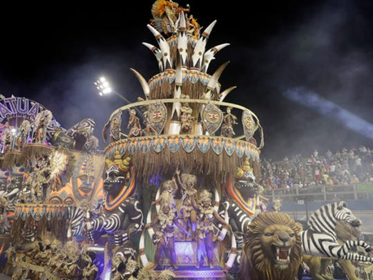 Dancers from the Academicos do Tatuape samba school perform on a float during a carnival parade in Sao Paulo, Brazil, early Saturday, Feb. 25, 2017.