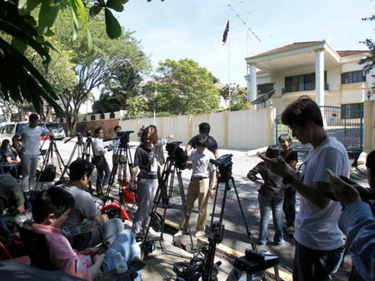 Journalists gather in front of North Korean Embassy in Kuala Lumpur, Malaysia, Saturday, Feb. 25, 2017. According to police Friday, forensics stated that the banned chemical weapon VX nerve agent was used to kill Kim Jong Nam, the North Korean ruler's outcast half brother who was poisoned last week at the airport.