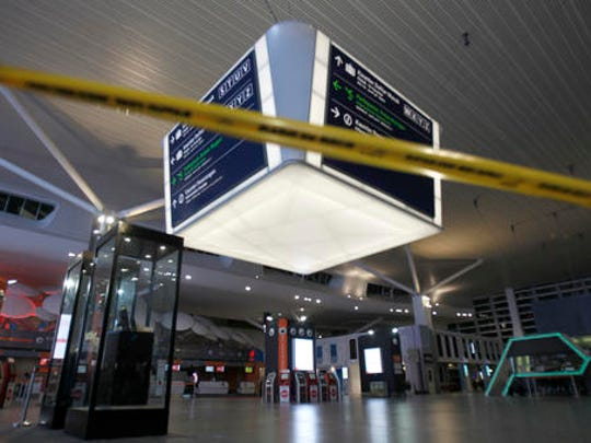 Tape blocks the entrance to the main hall of Kuala Lumpur International Airport 2 for the decontamination process in Sepang, Malaysia on Sunday, Feb. 26, 2017. Malaysian police ordered a sweep of Kuala Lumpur airport for toxic chemicals and other hazardous substances following the killing of Kim Jong Nam.