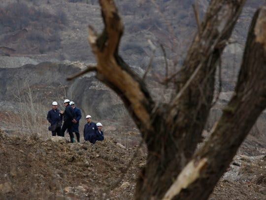 Engineers surveying the damage after a landslide near the Bosnian town of Kakanj, 50 kms north of Sarajevo on Friday, Feb. 24, 2017. More than 150 people have been forced to evacuate their homes in central Bosnia due to a major landslide at a nearby open pit coal mine that has threatened to bury their villages.