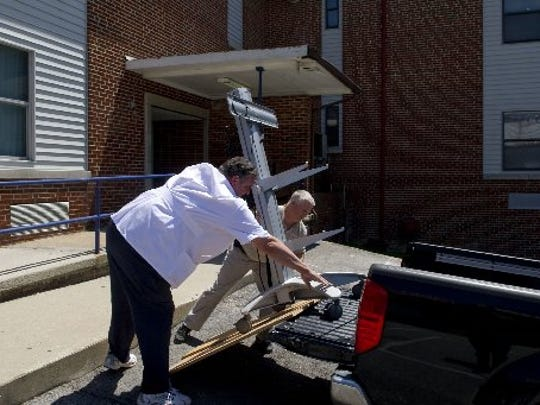 Part of a device doctors use to communicate with patients remotely is loaded onto a truck and removed from the Scott County Hospital in Oneida as the facility prepared to close in May 2012. It reopened just over a year later, closed again in 2016 and is expected to reopen as Big South Fork Medical Center.