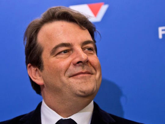 FILE - In this file photo taken on Thursday, Dec. 15, 2016, Thierry Solere, the conservative presidential candidate Francois Fillon's spokesman, smiles during a media conference in Paris. French conservative Francois Fillon's presidential bid took another blow Friday March 3, 2017 after his spokesman Thierry Solere resigned from his campaign team.