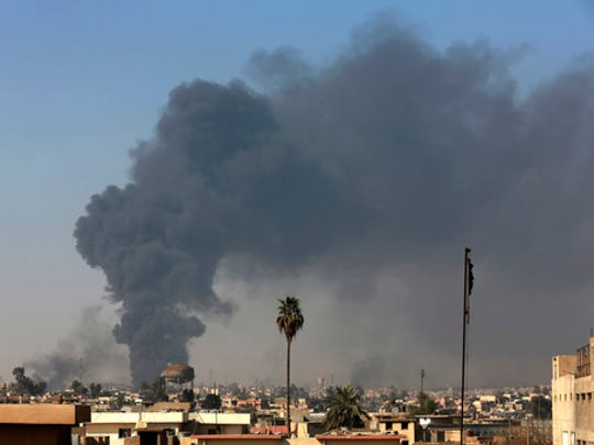 Smoke rises as Iraqi security forces advance during fighting against Islamic State militants in western Mosul, Iraq, Tuesday, March 7, 2017. U.S.-backed Iraqi forces were fighting their way through a government complex in the heart of western Mosul after storming the buildings in an overnight raid, and were facing fierce counterattacks Tuesday from the Islamic State group.