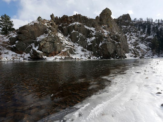 FILE - In this Dec. 17, 2015 file photo, the Poudre River winds through a scenic canyon outside Fort Collins, Colo. Global warming could melt mountain snows more slowly, researchers said Monday, Feb. 27, 2017, a peculiar finding that might be bad news for the American West and other regions that depend on snow for water.