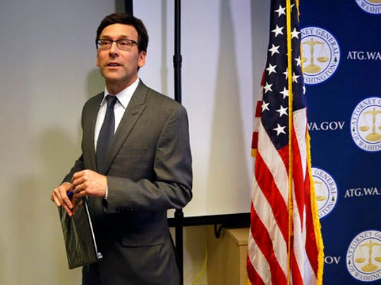 Washington State Attorney General Bob Ferguson finishes a news conference about the state's response to President Trump's revised travel ban Thursday, March 9, 2017, in Seattle. Legal challenges against Trump's revised travel ban mounted Thursday as Washington state said it would renew its request to block the executive order. It came a day after Hawaii launched its own lawsuit, and Ferguson said both Oregon and New York had asked to join his state's legal action.