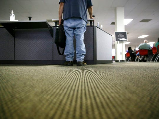 A lone job seeker checks in at the front desk of the Texas Workforce Solutions office in Dallas, Friday, March 10, 2017. U.S. employers added a robust 235,000 jobs in February and raised pay at a healthy pace, making it all but certain that the Federal Reserve will raise short-term interest rates the following week. Friday's jobs report from the government made clear that the economy remains on solid footing nearly eight years after the Great Recession ended.