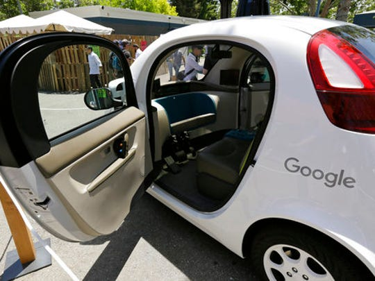 FILE - This May 18, 2016, file photo shows a Google self-driving car on display at Google's I/O conference in Mountain View, Calif. Cars with no steering wheel, no pedals and nobody at all inside could be driving themselves on California roads by the end of 2017, under proposed new rules that would give a powerful boost to the technology from the nation's most populous state.