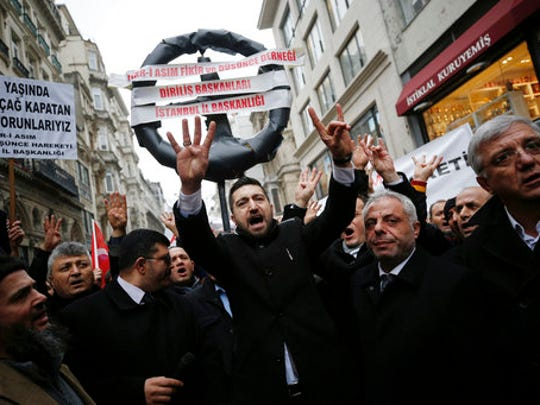 """Supporters of Turkey's President Recep Tayyip Erdogan walk to the Dutch consulate in Istanbul, Saturday, March 11, 2017. Turkey and the Netherlands sharply escalated a dispute between the two NATO allies on Saturday as the Dutch withdrew landing permission for the Turkish foreign minister's aircraft, drawing Turkish President Recep Tayyip Erdogan to call them """"fascists."""""""