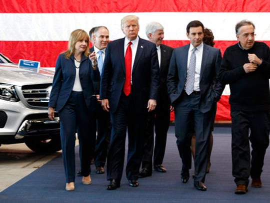 President Donald Trump tours the American Center of Mobility, Wednesday, March 15, 2017, in Ypsilanti Township, Mich. From left are, GM CEO Mary Barra, EPA administrator Scott Pruitt, Trump, Michigan Gov. Rick Snyder, Ford CEO Mark Fields, and Fiat Chrysler Sergio Marchionne.