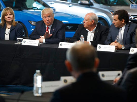 President Donald Trump speaks during a roundtable discussion at the American Center of Mobility, Wednesday, March 15, 2017, in Ypsilanti Township, Mich. From left are, GM CEO Mary Barra, the president, UAW President Dennis Williams and Ford CEO Mark Fields.