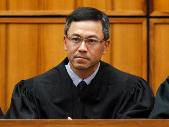 This December 2015 photo shows U.S. District Judge Derrick Watson in Honolulu. Hours before it was to take effect, President Donald Trump's revised travel ban was put on hold Wednesday, March 15, 2017, by Watson, a federal judge in Hawaii who questioned whether the administration was motivated by national security concerns.