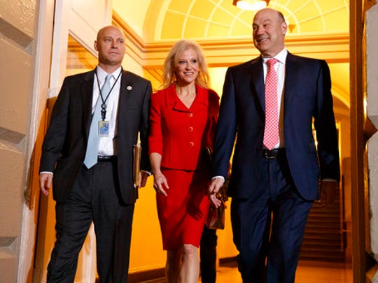White House Senior Adviser Kellyanne Conway, center, and National Economic Council director Gary Cohn arrive for a meeting on Capitol Hill in Washington, Tuesday, March 21, 2017, between President Donald Trump and Republicans to discuss health care.