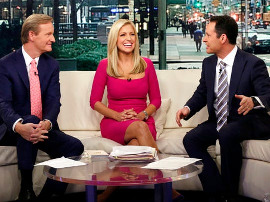 """FILE - In this Feb. 29, 2016 file photo, co-hosts  Steve Doocy, from left, Ainsley Earhardt and  Brian Kilmeade appear on the morning show """"Fox & Friends"""" in New York. """"Fox & Friends"""" has emerged as the morning television show of choice for President Donald Trump and his fans. Its average February 2017 audience of 1.72 million viewers was 49 percent over last year's, the Nielsen company said."""