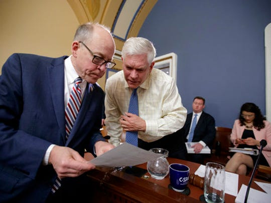 House Energy and Commerce Committee Chairman Rep. Greg Walden, R-Ore., left, confers with House Rules Committee Chairman Rep. Pete Sessions, R-Texas on Capitol Hill in Washington, Wednesday, March 22, 2017, during a meeting to shape the final version of the Republican health care bill before it goes to the floor for debate and a vote.
