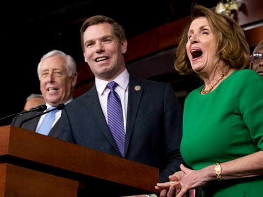 House Minority Leader Nancy Pelosi of Calif., right, and Democratic Whip Steny Hoyer, D-Md., react at a joke from Rep. Eric Swalwell, D-Calif., center, as he jokes while speaking at a news conference on Capitol Hill in Washington, Friday, March 24, 2017. Republican leaders have abruptly pulled their troubled health care overhaul bill off the House floor, short of votes and eager to avoid a humiliating defeat for President Donald Trump and GOP leaders.