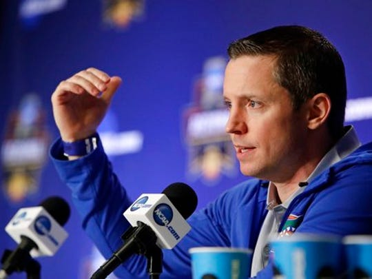 Florida head coach Mike White speaks during a news