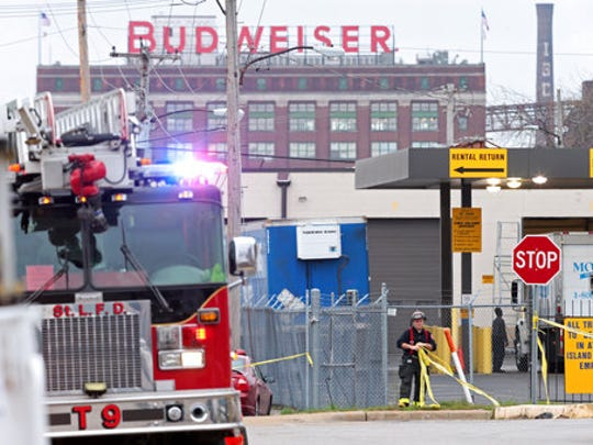 Crews work at the scene after a boiler exploded at a roof of a St. Louis box company and flew before crashing through the roof of a nearby laundry business on Monday, April 3, 2017. Authorities said several people were killed as a result of the explosion.