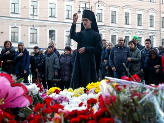 An Orthodox priest blesses at a symbolic memorial at Technologicheskiy Institute subway station in St. Petersburg, Russia, Tuesday, April 4, 2017. A bomb blast tore through a subway train deep under Russia's second-largest city St. Petersburg Monday, killing several people and wounding many more in a chaotic scene that left victims sprawled on a smoky platform.