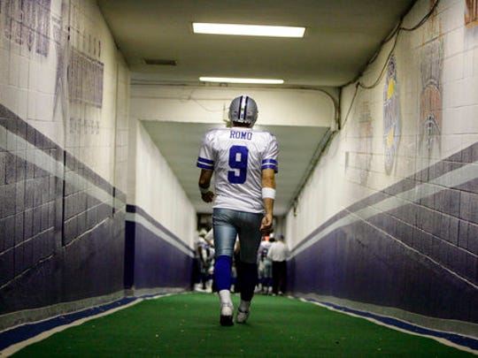 FILE - In this Dec. 20, 2008, file photo, Dallas Cowboys quarterback Tony Romo walks down the tunnel to the playing field at Texas Stadium before an NFL football game, in Irving, Texas. A person with knowledge of the decision says Romo is retiring rather than trying to chase a Super Bowl with another team after losing his starting job with the Cowboys. The all-time passing leader for the storied franchise is headed to the broadcast booth after considering those offers. The person spoke to The Associated Press on condition of anonymity Tuesday, April 4, 2017, because Romo's decision hasn't been announced.