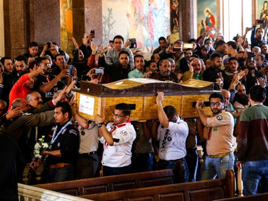 Men carry the coffin of a victim during the funeral