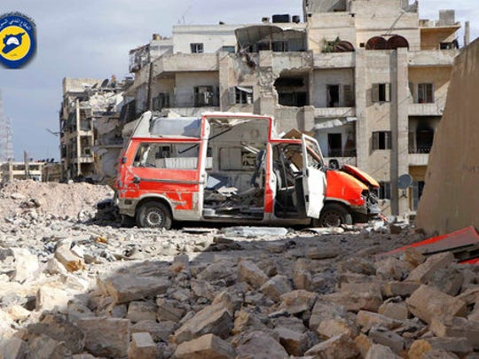 FILE - In this Sept. 23, 2016, file photo provided by the Syrian Civil Defense group known as the White Helmets, a destroyed ambulance is seen outside the Syrian Civil Defense main center after airstrikes in Ansari neighborhood in the rebel-held part of eastern Aleppo, Syria. With its missile strike on Shayrat Airbase in central Syria, Washington signaled that it had judged President Bashar Assad responsible for the horrific chemical weapons attack in north Syria that drew international outrage last week. But it is not the first or even deadliest atrocity of the war.