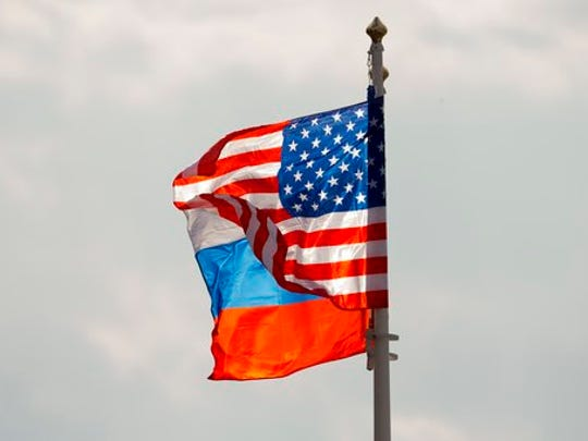 U.S. and Russian national flags wave on the wind before US Secretary of State Rex Tillerson arrival in Moscow's Vnukovo airport, Russia, Tuesday, April 11, 2017. Tillerson is due to meet with Russian Foreign Minister Sergey Lavrov on Wednesday.