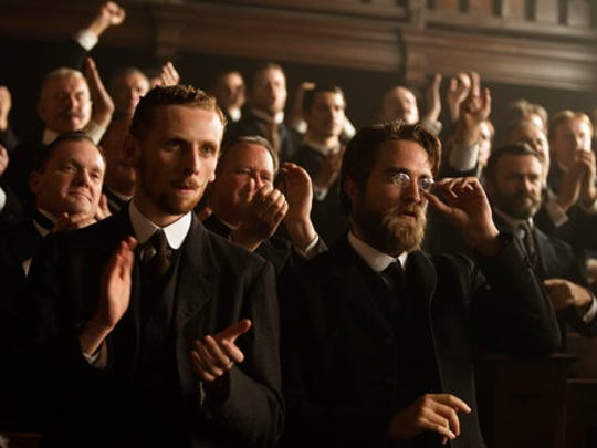 "This image released by Amazon Studios/Bleecker Street Films shows Edward Ashley, left, and Robert Pattinson in a scene from ""The Lost City of Z."""