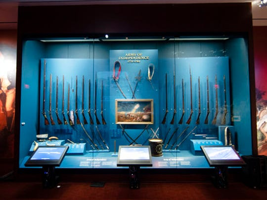 This Tuesday, April 4, 2017, photo shows a display of weapons used during the Revolutionary War, including a fife and drum, at the Museum of the American Revolution in Philadelphia. With muskets polished, flags aloft and one very commanding tent in place, the museum is at the ready. After nearly two decades of planning, the museum that tells the dramatic story of the founding of the United States opens in prime historic Philadelphia on April 19.