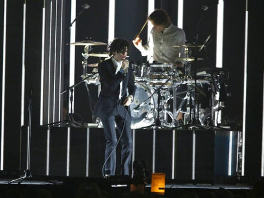FILE - In this Feb. 22, 2017 file photo, singer Matthew Healy of the band the 1975 performs on stage at the Brit Awards 2017 in London.  Healy remembers how emotional and impactful his first major concert was when he was just 8 years old. The artist was Michael Jackson, and Healy recalls the night so vividly. He's hoping his fans feel the same way when they see The 1975 on its latest U.S. arena tour, which launched this week.