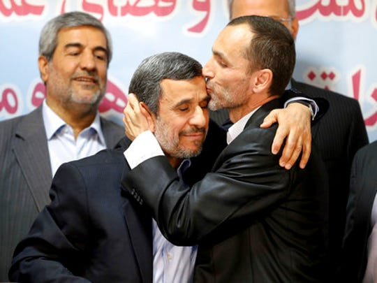 Hamid Baghaei, right, close ally of former Iranian President Mahmoud Ahmadinejad kisses his head after registering their candidacy for the upcoming presidential elections at the Interior Ministry in Tehran, Iran, Wednesday, April 12, 2017. Ahmadinejad on Wednesday unexpectedly filed to run in the country's May presidential election, contradicting a recommendation from the supreme leader to stay out of the race. Other close ally of Ahmadinejad, Esfandiar Rahim Mashie accompanies them.