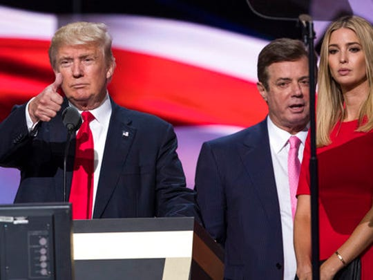 FILE - In this July 21, 2016 file photo, then-Trump Campaign manager Paul Manafort stands between the then-Republican presidential candidate Donald Trump and his daughter Ivanka Trump during a walk through at the Republican National Convention in Cleveland.  Last August, a handwritten ledger surfaced in Ukraine with dollar amounts and dates next to the name of Paul Manafort, who was then Donald Trump's campaign chairman. Ukrainian investigators called it evidence of off-the-books payments from a pro-Russian political party, and part of a larger pattern of corruption under the country's former president. Manafort, who worked for the party as an international political consultant, has publicly questioned the ledger's authenticity.