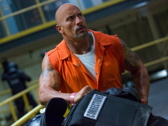 "This image released by Universal Pictures shows Dwayne Johnson in ""The Fate of the Furious."""