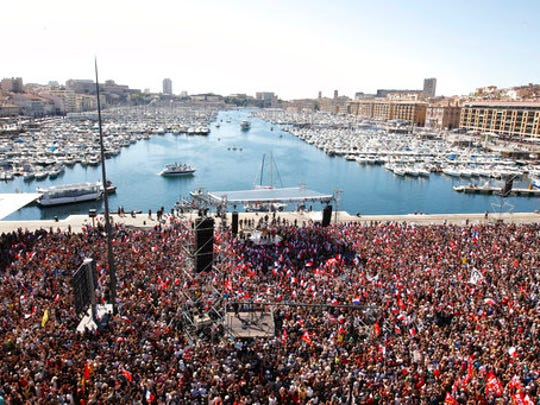 Supporters of French hard-left presidential candidate Jean-Luc Melenchon gather in Marseille's Old Port, southern France, to attend a campaign rally, Sunday, April 9, 2017. The two-round presidential election is set for April 23 and May 7.