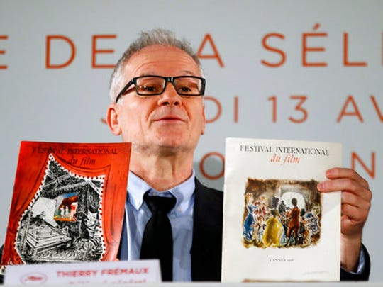 General Delegate of the Cannes Film Festival Thierry Fremaux displays 1946th Cannes festival books during a press conference for the presentation of the 70th Cannes film festival, in Paris, Thursday, April 13, 2017. A Civil War film by Sofia Coppola, a Ukrainian road movie and a film about AIDS activism are among 18 films competing for the top prizes at this year's Cannes Film Festival, which organizers hope can help counter nationalist sentiment.