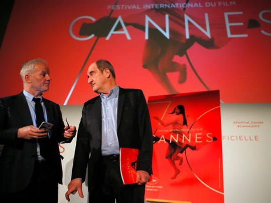 General Delegate of the Cannes Film Festival Thierry Fremaux, left and Cannes Film Festival President Pierre Lescure attend a press conference for the presentation of the 70th Cannes film festival, in Paris, Thursday, April 13, 2017. A Civil War film by Sofia Coppola, a Ukrainian road movie and a film about AIDS activism are among 18 films competing for the top prizes at this year's Cannes Film Festival, which organizers hope can help counter nationalist sentiment.