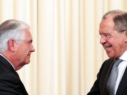 Russian Foreign Minister Sergey Lavrov, right, and US Secretary of State Rex Tillerson look at each other as they shake hands after the news conference following their talks in Moscow, Russia, Wednesday, April 12, 2017. Amid a fierce dispute over Syria, the United States and Russia agreed Wednesday to work together on an international investigation of a Syrian chemical weapons attack last week.