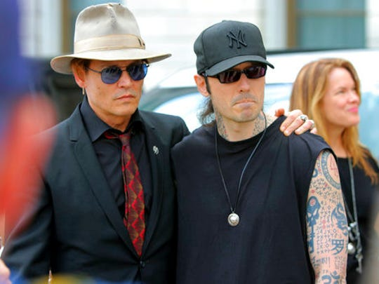Actor Johnny Depp, left, stands with former Arkansas death row inmate Damien Echols, before speaking at a rally opposing Arkansas' upcoming executions, which are set to begin next week, on the front steps of the Capitol Friday, April 14, 2017, in Little Rock, Ark.