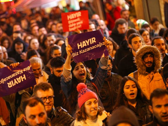 Supporters of the 'no' vote chant slogans as they protest in Istanbul, against the referendum outcome, Monday, April 17, 2017. The placards read in Turkish: 'No we will win'. Turkey's main opposition party urged the country's electoral board Monday to cancel the results of a landmark referendum that granted sweeping new powers to Erdogan, citing what it called substantial voting irregularities.
