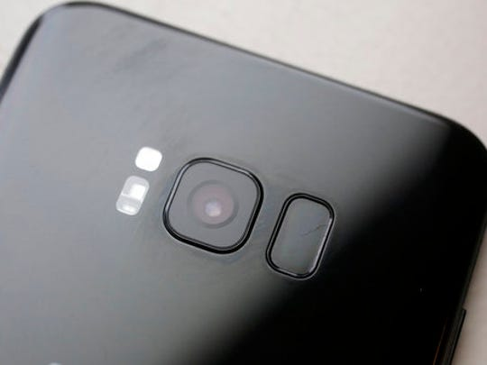 The iris scanner, center, and camera lens, right, are shown on the back of the Samsung Galaxy S8 Plus, Monday, April 17, 2017, in New York. There's a lot of value in the new phone, including a larger screen and more storage. But many cheaper phones do just fine.